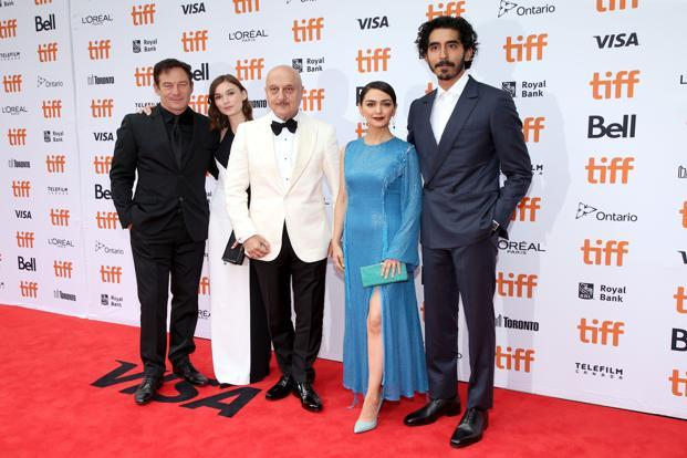 (L-R) Jason Isaacs, Tilda Cobham-Hervey, Anupam Kher, Nazanin Boniadi and Dev Patel attend the 'Hotel Mumbai' premiere during 2018 Toronto International Film Festival at Princess of Wales Theatre on 7 September in Toronto. Photo: AFP