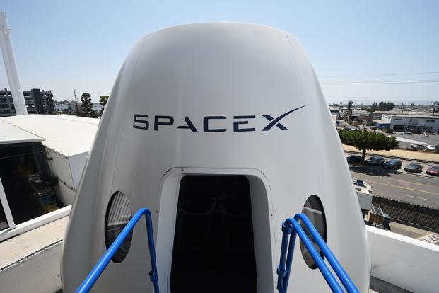 A mock up of the Crew Dragon spacecraft is displayed during a media tour of SpaceX headquarters and rocket factory in Hawthorne, California. File Photo: AFP