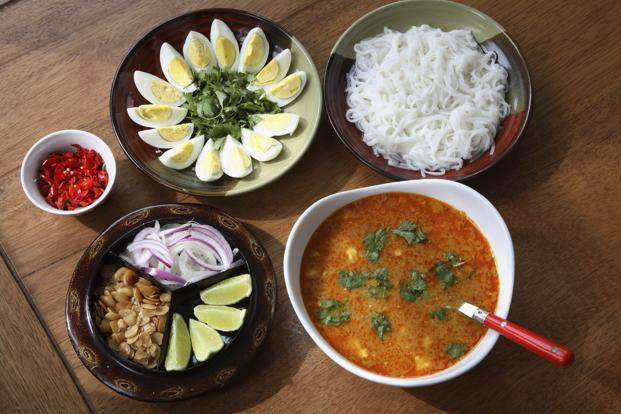 'Mohinga' with accompaniments. Photo: Getty Images