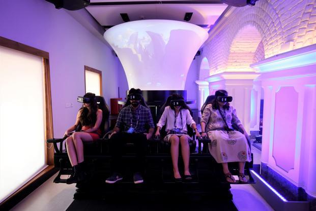 Visitors at the Samsung Opera House in Bengaluru enjoy a VR experience. Photo: Ramegowda Bopaiah/Mint