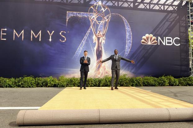 Colin Jost (L) and Michael Che, co-hosts for the 70th Emmy Awards, react after rolling out the gold carpet outside the Microsoft Theatre on 13 September in Los Angeles. The awards will be held on Monday. Photo: AP
