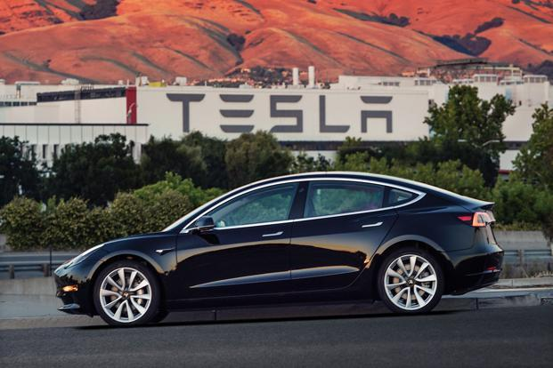 Elon Musk has driven Tesla to the verge of profitability with a costly ramp-up of production of its Model 3 sedan over the past year. Photo: AP