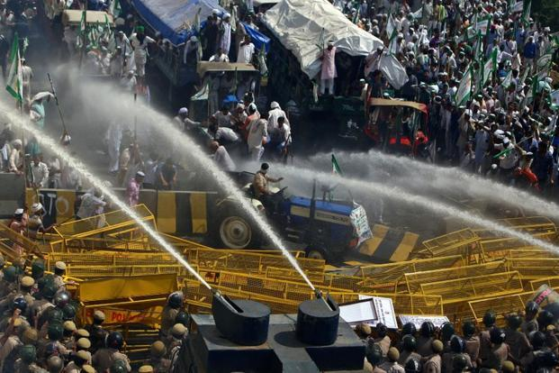 Police use water cannons to disperse farmers during a protest demanding better price for their produce on the outskirts of New Delhi on 2 October 2018. Photo: Reuters