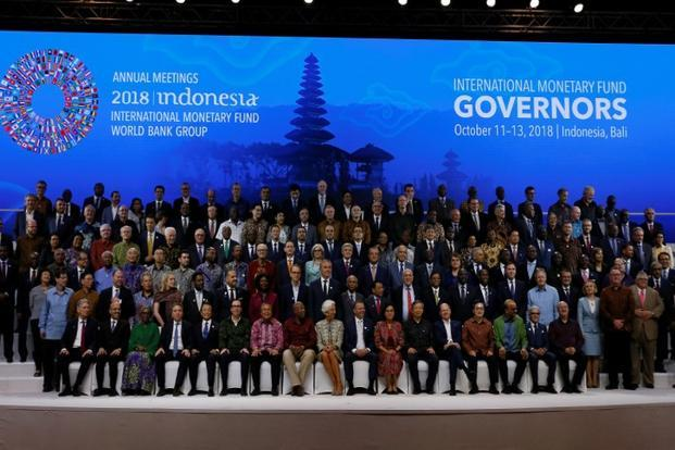 Christine Lagarde (CF), Central Bank governors and finance ministers pose for a group photo at the IMF - World Bank Group Annual Meeting 2018 in Bali on 13 October 2018. Photo: Reuters