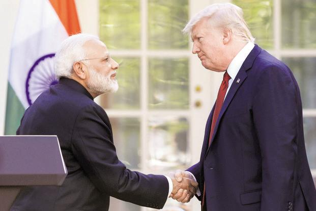 Indian Prime MInister Narendra Modi with US President Donald Trump. Escalating the global trade conflict is the last thing the Indian economy needs today. Photo: AP