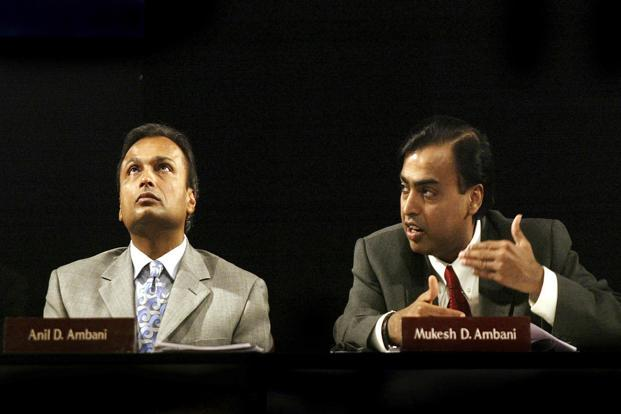 Anil Ambani and Mukesh Ambani at an Reliance Industries meeting during the peak of their feud in 2004. In 2005, Mukesh got control of the flagship oil refining and petrochemicals, while Anil got the newer businesses such as power generation and financial services. Photo: Reuters