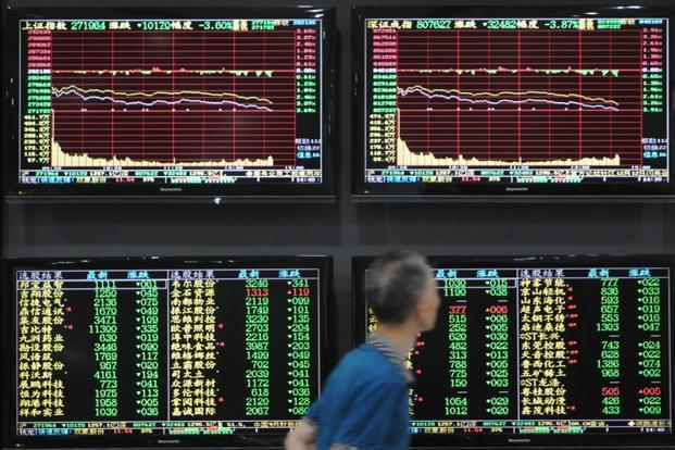 China's Shanghai Composite rebounded after hitting a four-year low and stocks in Hong Kong climbed after early losses. Photo: Reuters