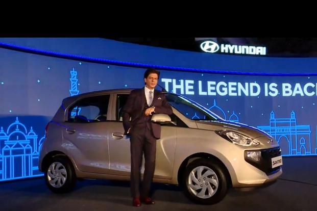 Actor Shah Rukh Khan, brand ambassador of Hyundai India, with the new Santro in New Delhi on Tuesday. Photo: PTI