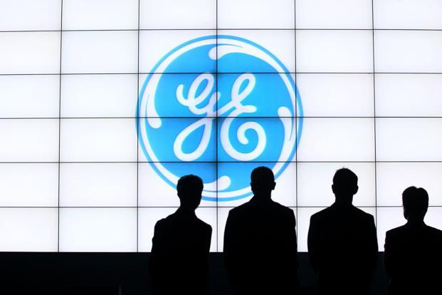 General Electric cuts dividend as it reports huge loss