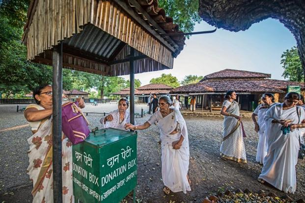 A group of women visitors near the donation box at the Gandhi Ashram in Sevagram. Photo: Pradeep Gaur/Mint