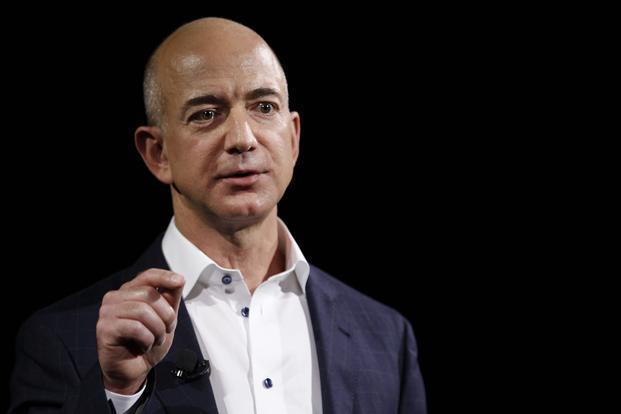 Bezos Says Robots Won T Replace Humans Ackman Wants A Massage