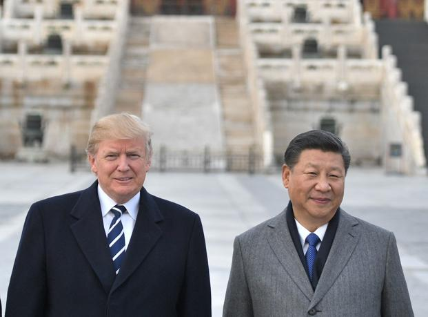 "Donald Trump said trade talks were ""moving along nicely"" and that meetings were ""being scheduled"" at the G20 summit in Buenos Aires. File Photo: AFP"