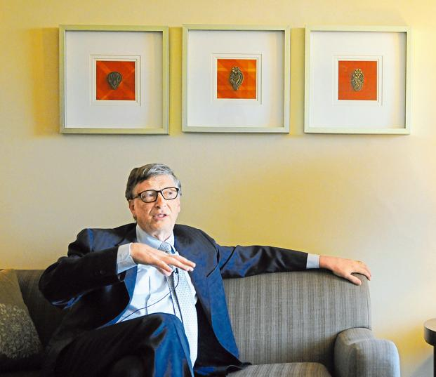 Bill Gates brandishes jar of poop, talks toilet technology