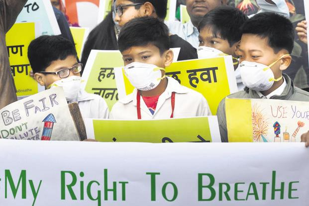 Schoolchildren protest against rising air pollution levels in New Delhi on Tuesday. Photo: AFP