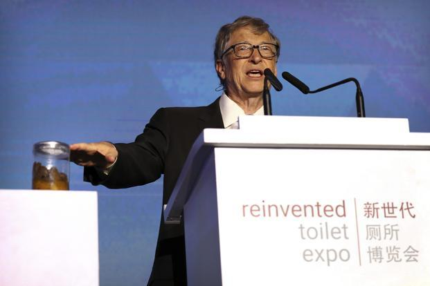 Bill Gates, former Microsoft CEO and co-founder of the Bill and Melinda Gates Foundation, gestures to a jar of human feces as he speaks at the Reinvented Toilet Expo in Beijing on Tuesday. Photo: AP