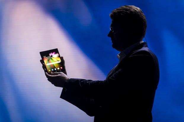 Samsung isn't the first to try foldable phones, but the company's display know-how, reach and marketing power could take the form mainstream. Photo: Bloomberg