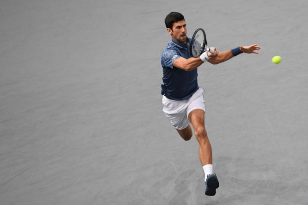 Djokovic returns the ball to Russia's Karen Khachanov during the men's singles final tennis match of the Rolex Paris Masters on 4 November. Photo: AFP