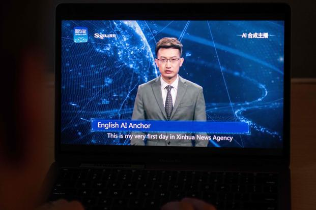 This photo illustration shows a man watching an artificial intelligence (AI) news anchor from a state-controlled news broadcaster, on his computer in Beijing. Photo: AFP