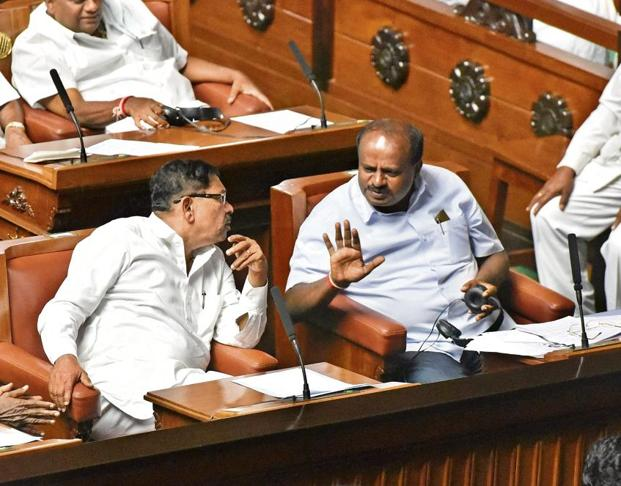 Karnataka chief minister H D Kumaraswamy (right) with deputy CM G.Parameshwara. Arijit Sen/HT