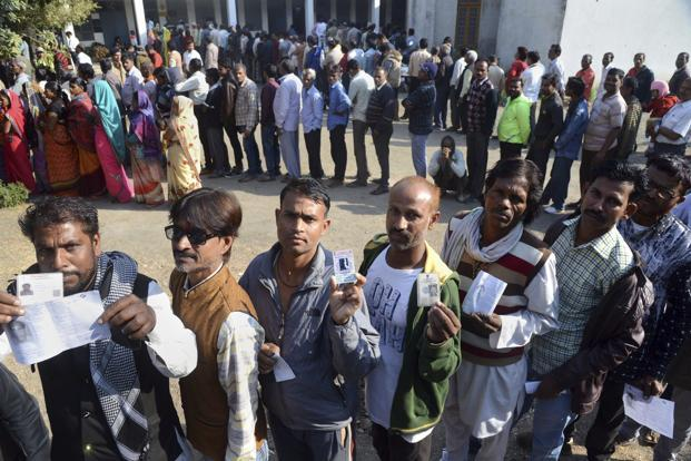 People wait with their identity cards to cast their votes for the Assembly elections, in Jabalpur, Madhya Pradesh on 28 November 2018. Photo: PTI