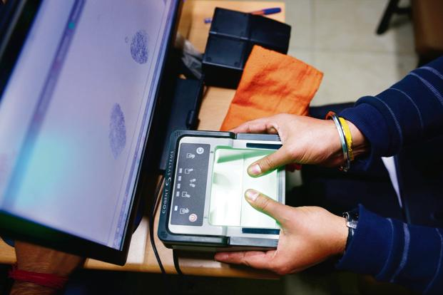 UIDAI officer doing demo for new Aadhaar card process. Photo: Pradeep Gaur/Mint