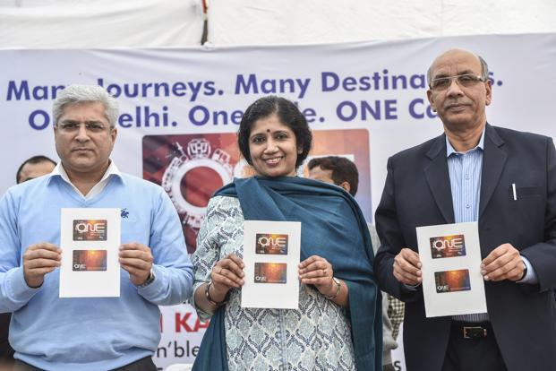 Delhi transport minister Kailash Gahlot, transport commissioner Varsha Joshi and DMRC managing director Mangu Singh launching new common mobility card titled 'ONE' , in New Delhi on 3 December 2018. Photo: PTI