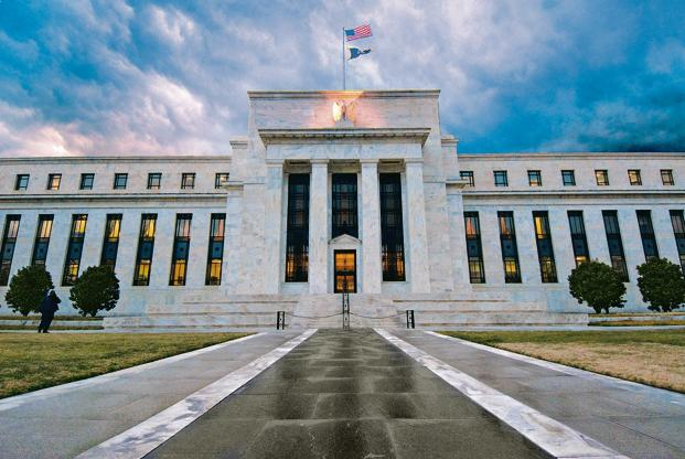 Fed hawks have long contended that financial stability risks call for further rate hikes to tamp down dangerous risk-taking Photo: Bloomberg