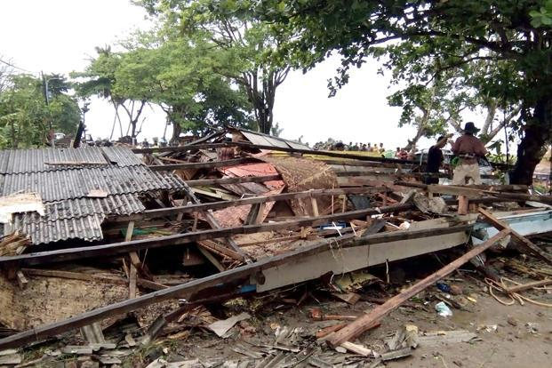 Hundreds of homes and other buildings were 'heavily damaged' in the tsunami in Indonesia.  Photo: AFP