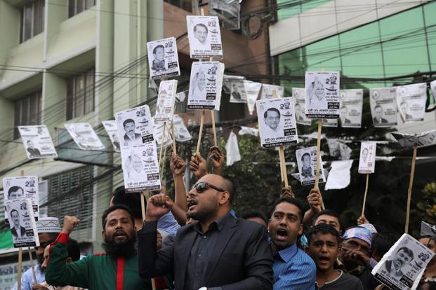 Bangladesh election: 16 reported dead as opposition rejects 'farcical' vote