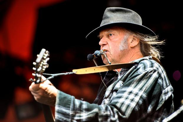 Neil Young performing at the Roskilde Festival in Denmark, in 2016. Photo: Reuters