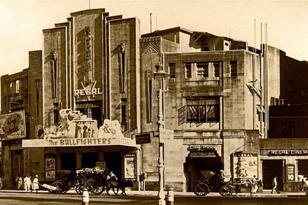 Bullock carts outside Regal Cinema in Colaba, Mumbai, where Laurel and Hardy's 'The Bull Fighters' was showing, 1945.