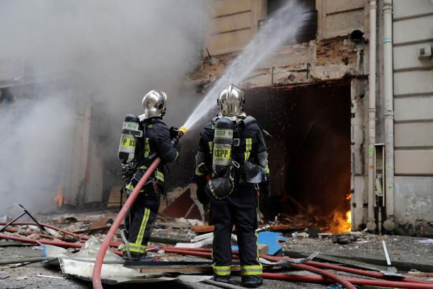 Firefighters extinguish a fire after the explosion of a bakery on the corner of the streets Saint-Cecile and Rue de ...</p>                                         </div>                                         <div class=
