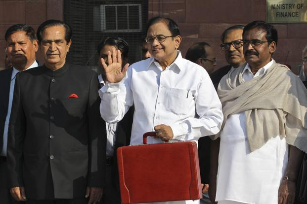 Finance minister P. Chidambaram leaves his office to present the 2013 budget in New Delhi on 28 February. Photo: B Mathur/Reuters