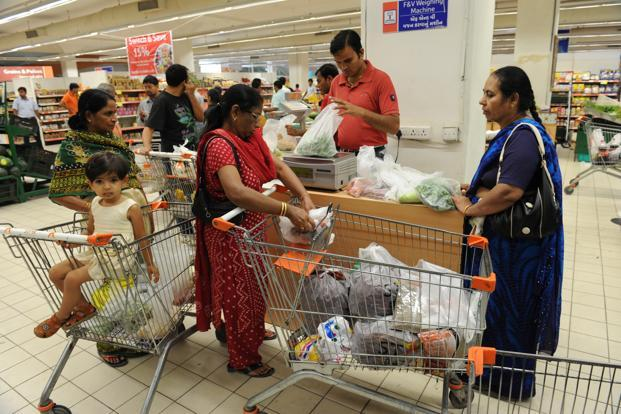 The share of household expenditure on food and groceries fell to 36% in 2014 from 40% in the previous year, leaving consumers with more money to spend on non-food essentials. Photo: Mint