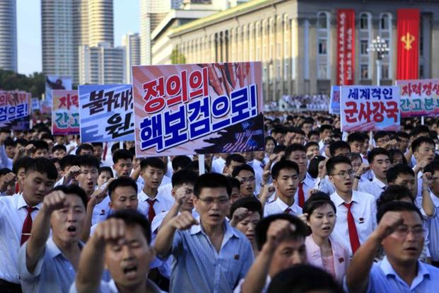 Tens of thousands of North Koreans gathered for a rally at Kim Il Sung Square carrying placards and propaganda slogans as a show of support for their rejection of the United Nations' latest round of sanctions on 9 August 2017, in Pyongyang. Photo:Jon Chol Jin/AP
