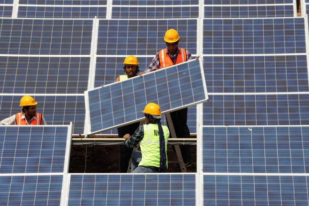 Budget 2018 has eliminated the 5% customs duty on solar tempered glass used for manufacturing cells, panels and modules, a move that will benefit domestic solar equipment makers. Photo: AFP