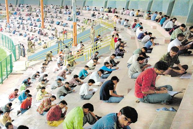 Indian youths take a written entrance exam for a government job in Bhopal. Photo: AFP
