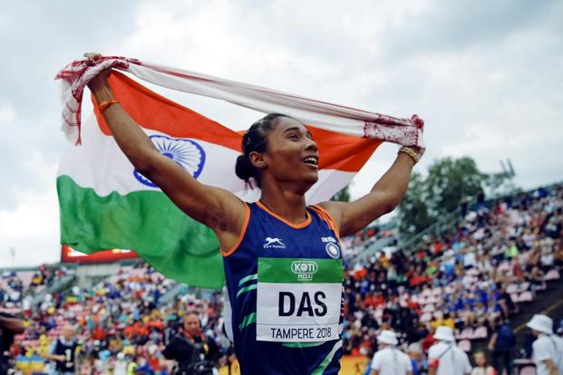 Hima Das celebrates her victory in the women's 400m event at the IAAF World U20 Championships in Tampere, Finland, in July. Photo: Reuters