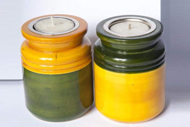 Yellow Button, 1st Cross, Indiranagar, Bangalore: Channapatna wood tea light holder, Rs710 for a set of two.