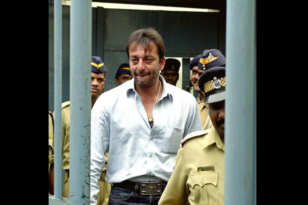<b>File Photo:</b>     Actor Sanjay Dutt, accused for illegal possession of firearms,      leaves a courthouse in Mumbai on 19 August 2002. The Supreme Court      has upheld the conviction of Dutt but reduced his sentence from 6      to 5 years under Arms Act. AP