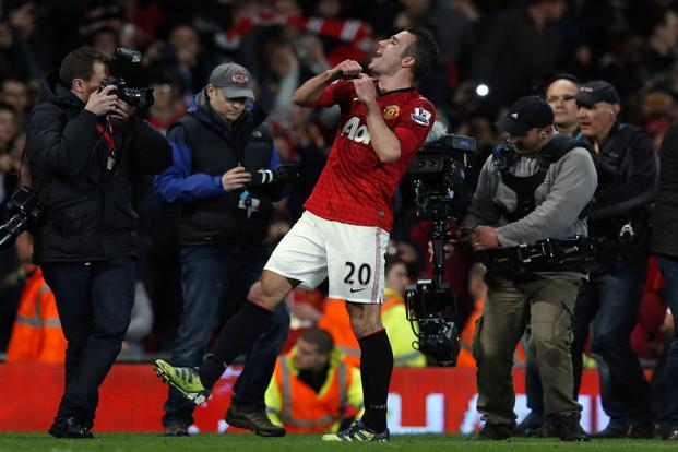 Manchester United's Robin Van Persie celebrates after his team's win over Aston Villa meant it would take the Premier League title. The 29-year-old Dutchman's hat-trick against Aston Villa gave United a 16-point lead over Manchester City. Reuters