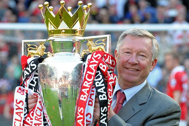 Sir Alex Ferguson celebrates with the English Premier League trophy on 22 May 2011. Fergie will retire at the end of the season after the West Bromwich Albion game on 19 May, Manchester United has announced. AFP
