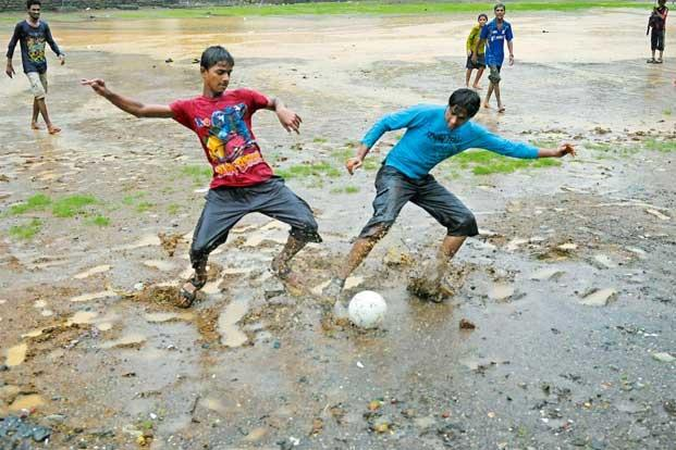 photo essay rain diaries slideshow livemint neighbourhood boys playing football on a rainy day in thane on the outskirts of mumbai