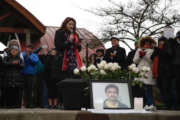 Americans for Refugees and Immigrants executive director Anny Khan (centre) speaks during a vigil in honour of Srinivas Kuchibhotla (pictured in foreground), an Indian immigrant who was recently shot and killed in Kansas, at Crossroads Park in Bellevue, Washington, on Sunday. AFP