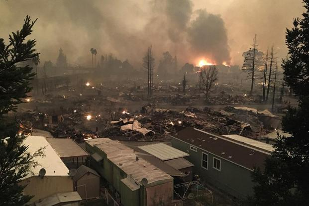 The devastated Journey's End mobile home park smolders in Santa Rosa, California on Monday. AP